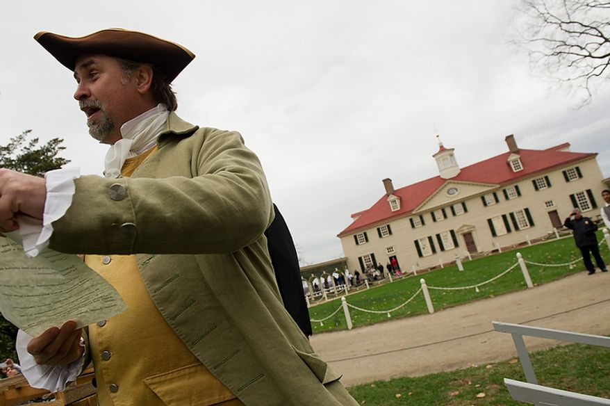 Liberty, the turkey pardoned by President Obama, is welcomed Nov. 23, 2011, to Mount Vernon in Virginia by Tom Plott, who plays James Anderson, the farm manager for George Washington. (Andrew Harnik/The Washington Times)