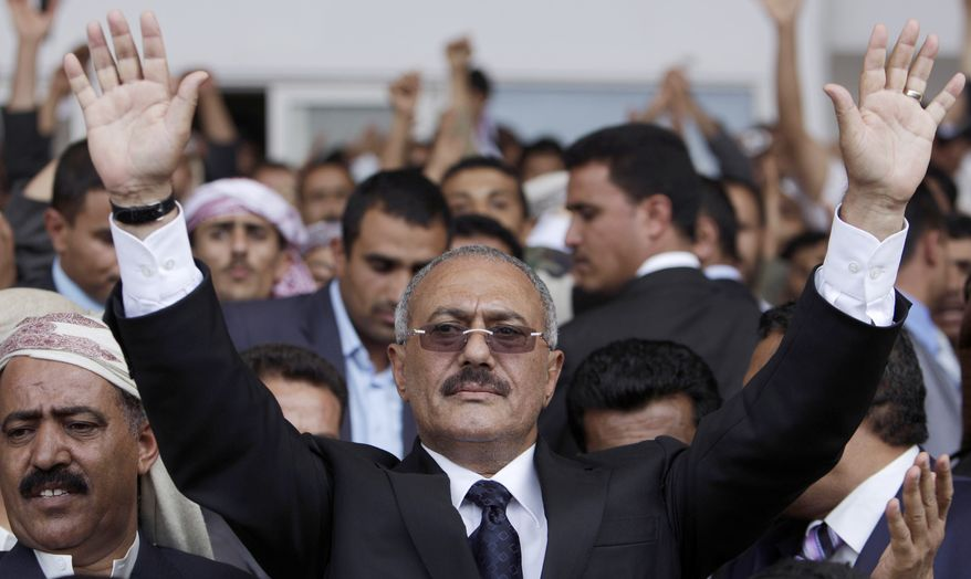 ** FILE ** In this April 15, 2011, file photo, Yemeni President Ali Abdullah Saleh waves to his supporters, not pictured, during a rally in Sanaa, Yemen, after returned from medical treatment in Saudi Arabia. (AP Photo/Muhammed Muheisen, File)