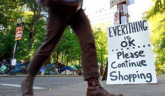 A sign is posted as a joke at an entrance to the Occupy Portland camp Oregon. Occupy protesters want shoppers to boycott door-buster sales at big-box stores on Black Friday. (Associated Press)