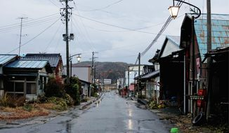 Streetlights shine in the abandoned town of Iitate, northeastern Japan. Though the town lies outside the official exclusion zone around the Fukushima Dai-ichi nuclear plant, radiation levels were higher than some areas inside - forcing residents to evacuate months after the nuclear plant began leaking radiation.(Associated Press)