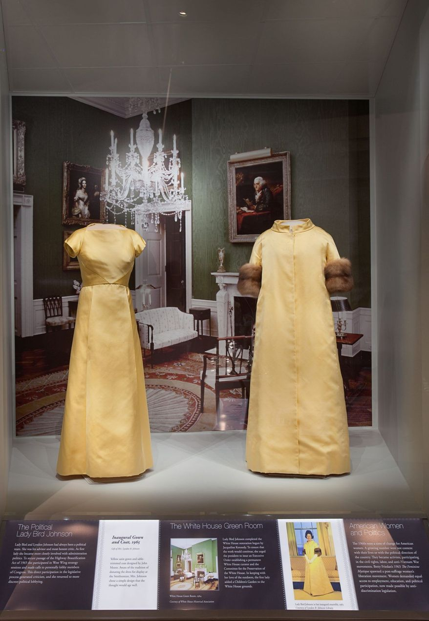 Lady Bird Johnson's 1965 yellow satin inaugural gown and sable-trimmed coat, designed by John Moore, is shown. Her beautification programs get attention, too, as she is one of four first ladies chosen for extra focus on their achievements. (Photo courtesy Smithsonial National Museum of American History)