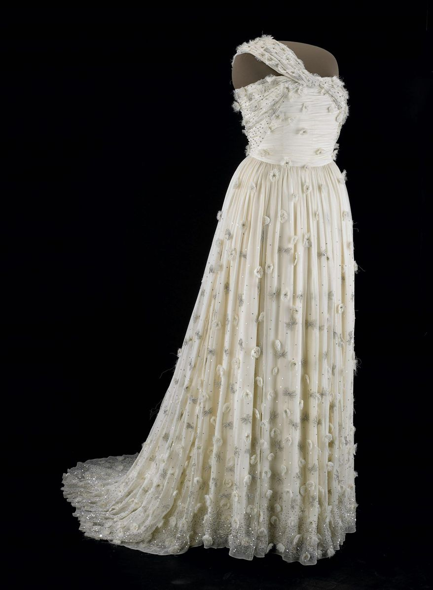 Michelle Obama's one-shouldered white silk chiffon gown with organza flowers and Swarovski crystals, designed by Jason Wu, is on display, but there's no mention of her campaign to lessen juvenile obesity. (Photo courtesy Smithsonial National Museum of American History)