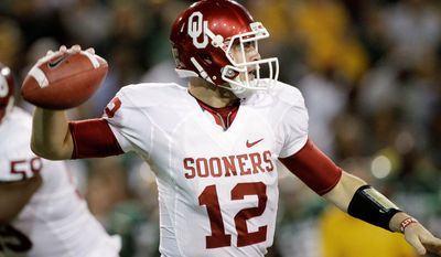 Oklahoma quarterback Landry Jones eclipsed former Sooners Jason White and Sam Bradford - both former Heisman Trophy winners - to become the school's all-time leading passer. (Associated Press)