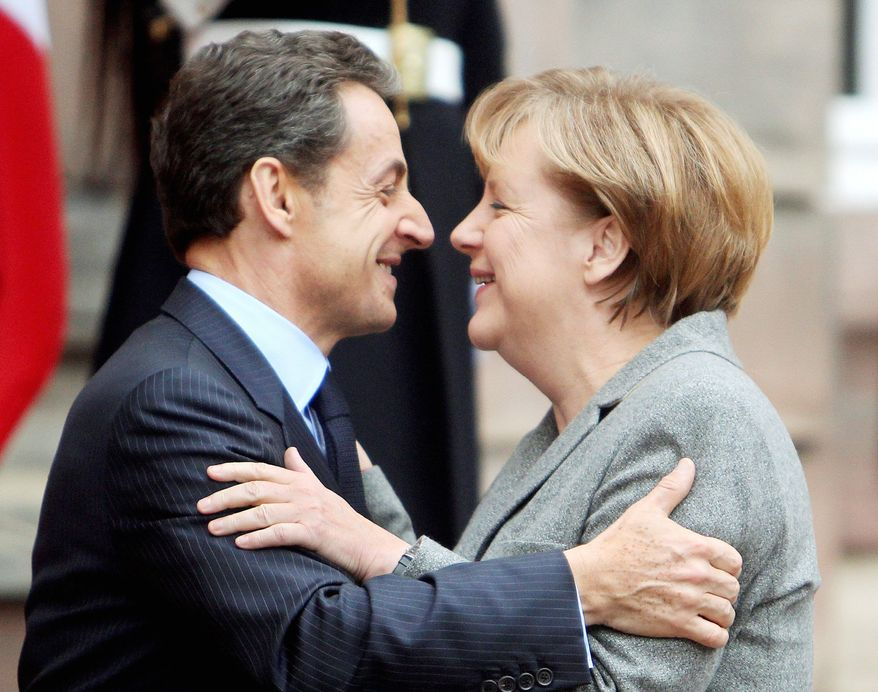 ** FILE ** German Chancellor Angela Merkel and French President Nicolas Sarkozy say goodbye after their meeting in Strasbourg, France, on Thursday, Nov. 24, 2011. (AP Photo/Michael Probst)