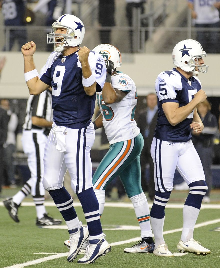 Dallas Cowboys quarterback Tony Romo and kicker Dan Bailey celebrate Bailey's game-winning field goal against the Miami Dolphins, Thursday, Nov. 24, 2011, in Arlington, Texas. The Cowboys won 20-19. (AP Photo/Matt Strasen)