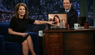 "In this image released by NBC, Republican presidential candidate Michele Bachmann, of Minnesota, left, points to a photo of host Jimmy Fallon, dressed as Bachmann, during a visit to ""Late Night with Jimmy Fallon,"" that aired early Tuesday, Nov. 22, 2011, in New York. (AP Photo/NBC, Lloyd Bishop)"