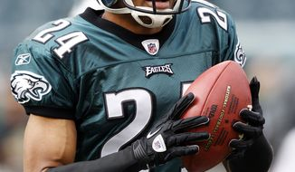 Philadelphia Eagles cornerback Nnamdi Asomugha injured his left knee in practice and his status will be updated Friday. (AP Photo/Mel Evans)