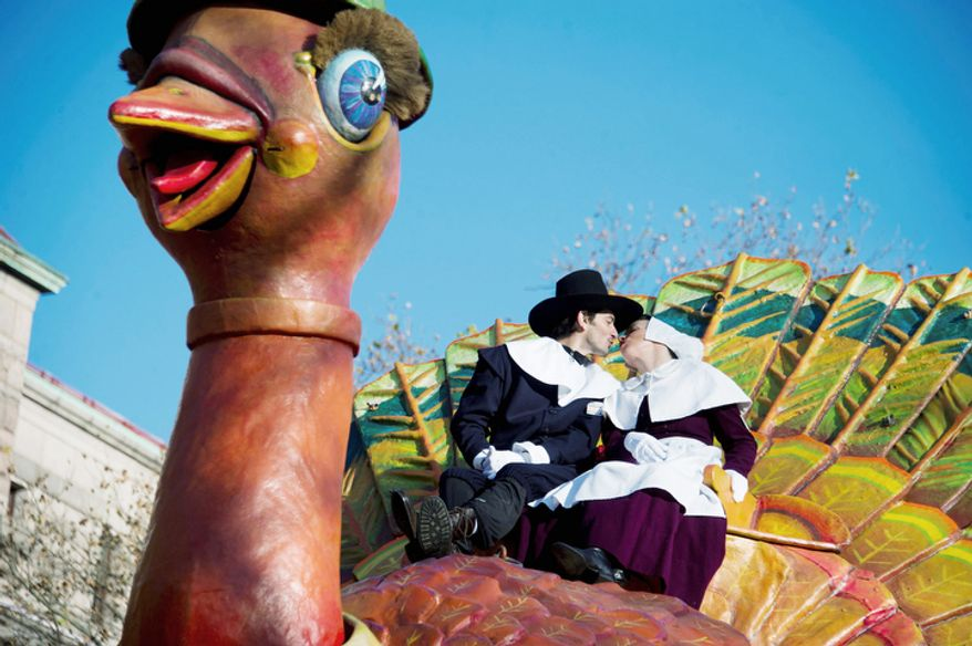 Gabriele Corcos and Debi Mazar ride a float in the Macy's Thanksgiving Day Parade. (AP Photo/Charles Sykes)