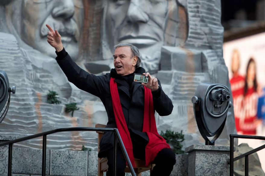 Musician Neil Diamond rides a float during the Macy's Thanksgiving Day Parade. (AP Photo/Andrew Burton)