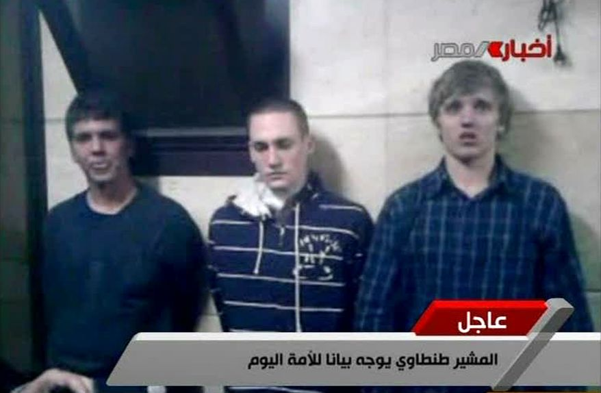 ** FILE ** In this Tuesday, Nov. 22, 2011, file image from Egyptian state television, three American students are displayed to the camera by Egyptian authorities following their arrest during protests in Cairo, where an Egyptian official said they were throwing firebombs at security forces. A spokeswoman for the American University in Cairo identified the students as Luke Gates, a 21-year-old Indiana University student from Bloomington, Ind.; Derrik Sweeney, a 19-year-old Georgetown University student from Jefferson City, Mo.; and Gregory Porter, a 19 year-old Drexel University student from Glenside, Pa. (AP Photo/Egyptian TV, File)