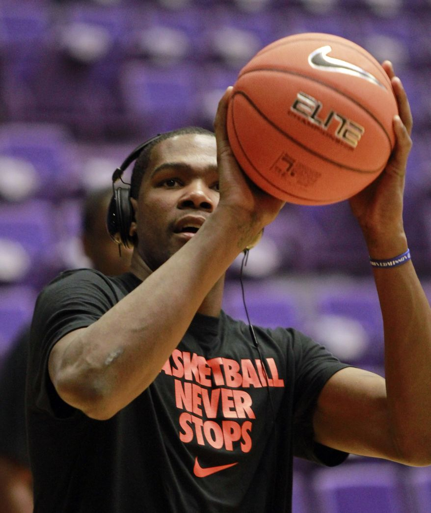 Oklahoma City forward Kevin Durant warms up before the Rip City Basketball Classic basketball game in Portland, Ore., Sunday, Nov. 6, 2011. The game, which showcases various NBA Players, was put together by Portland Trail Blazers forward LaMarcus Aldridge. (AP Photo/Don Ryan)