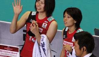 Japan national team player Risa Shinnabe, idolized by millions of schoolgirls, wears a Japan Tobacco logo on her uniform as she waves to fans after a win over the United States at the Yoyogi National Stadium in Tokyo, Japan, on Nov. 18, 2011. (Christopher Johnson/Special to The Washington Times)