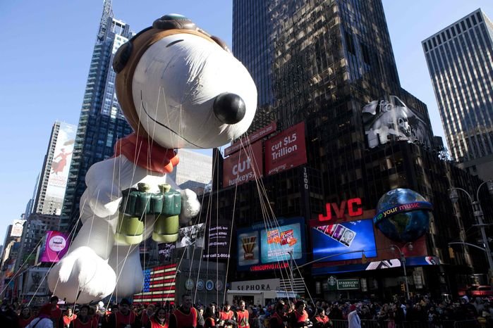 """The """"Snoopy"""" float is seen during the Macy's Thanksgiving Day Parade in Times Square in New York on Thursday, Nov. 24, 2011. The parade premiered in 1924; this is its 85th year. (AP Photo/Andrew Burton)"""