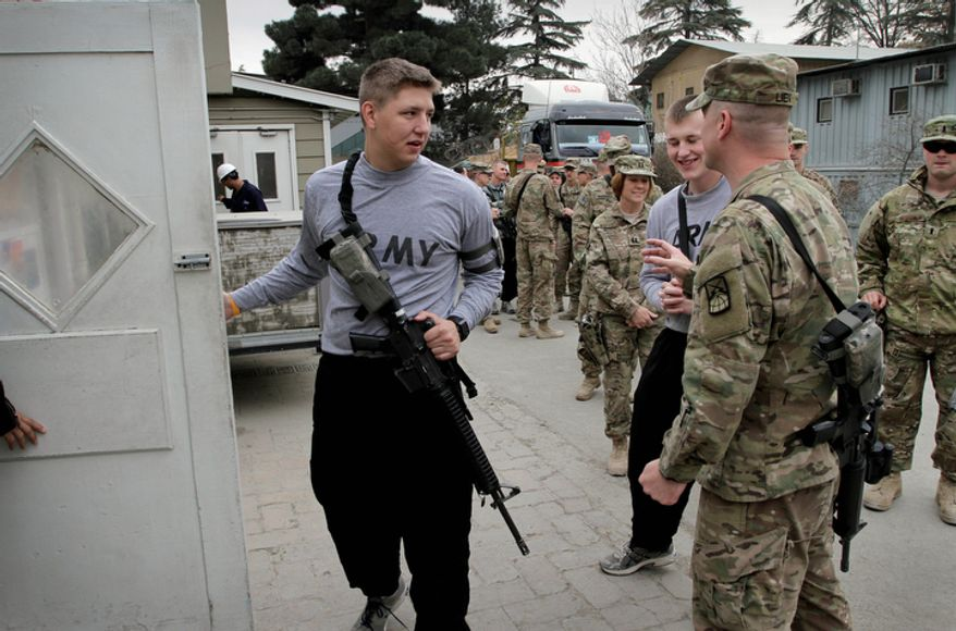 U.S. soldiers walk into a dining facility to take their lunch meal to mark Thanksgiving Day at the U.S. base Camp Eggers in Kabul, Afghanistan, Thursday, Nov. 24, 2011. (AP Photo/Musadeq Sadeq)