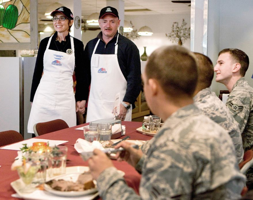 PREMIUM CONTENT--HIGHER RATES APPLY FOR NON-PHOTOSTREAM MEMBERS - U.S. Rep Gabrielle Giffords, D-Ariz., and her husband, retired Capt. Mark Kelly, meet both active and retired airmen after serving a Thanksgiving meal to troops at Davis-Monthan Air Force Base, Thursday, Nov. 24, 2011, in Tucson, Ariz. (AP Photo/Matt York)