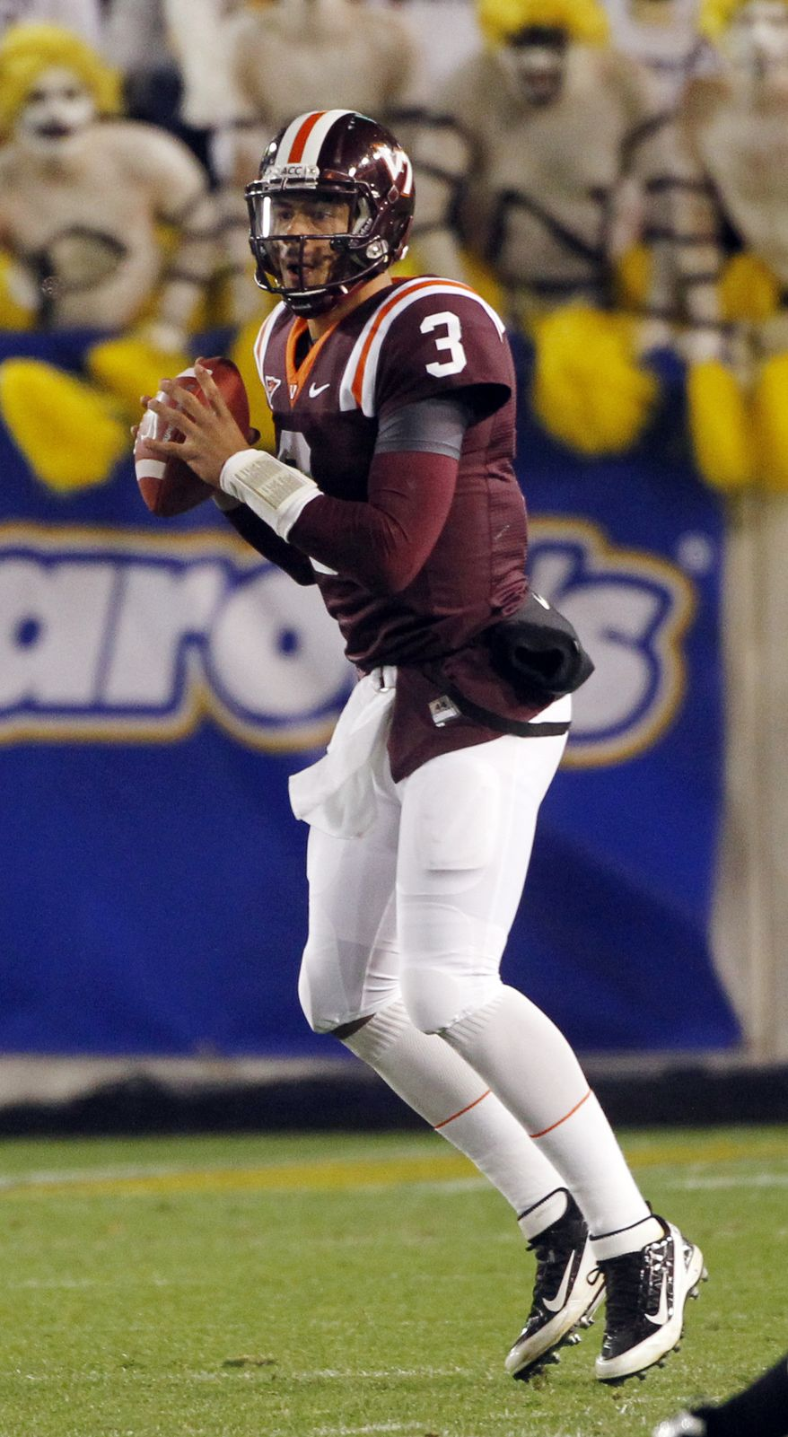 Virginia Tech quarterback is a dual threat, totaling 2,338 yards and 16 touchdowns in the air and 387 yards and nine touchdowns on the ground. (AP Photo/John Bazemore)