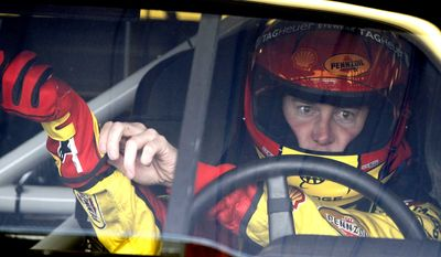NASCAR fined Kurt Busch $50,000 on Friday for his behavior - which included an obscene gesture and verbal abuse to a reporter - during the Spring Cup finale last week. (AP Photo/Ross D. Franklin)