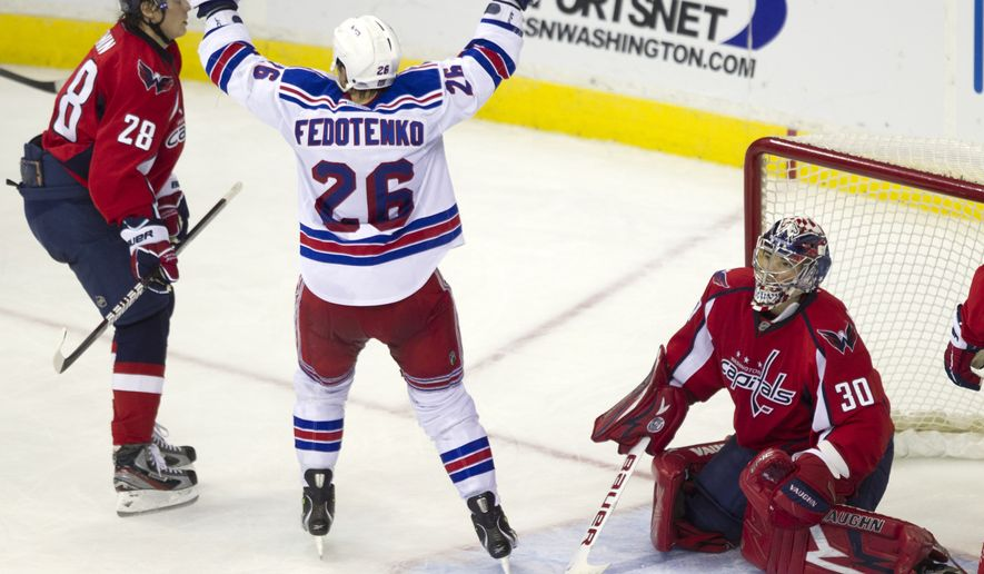 New York Rangers left wing Ruslan Fedotenko scored twice in the 6-3 win over the Washington Capitals on Friday, Nov. 25, 2011, in Washington. (AP Photo/Evan Vucci)