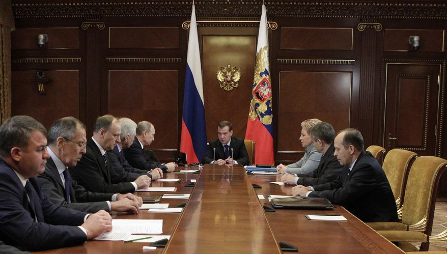 Russian President Dmitry Medvedev (center) chairs a Security Council meeting in the Gorki residence outside Moscow on Nov. 23, 2011. From left is Defense Minister Anatoly Serdyukov, Foreign Minister Sergey Lavrov, Security Council Secretary Nikolai Patrushev, Duma Speaker Boris Gryzlov and Prime Minister Vladimir Putin. (Associated Press/RIA Novosti, Mikhail Klimentyev, Presidential Press Service)