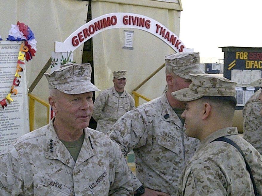 Marine Gen. James Amos visits Combat Outpost Geronimo in southern Afghanistan, Thursday, Nov. 24, 2011. (AP Photo/Robert Burns)