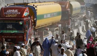 ** FILE ** NATO fuel tankers enter Afghanistan through Pakistan's border crossing in Torkham, east of Kabul, on Oct. 10, 2010. (AP Photo/Rahmat Gul)