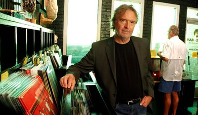 "Charles Frazier, the author of ""Nightwoods"" and ""Cold Mountain,"" spends time in the record store of his friend, musician Jack White, in Nashville, Tenn. Like the written word, music is a big part of Frazier's life. He has begun assembling a soundtrack to give him inspiration for his next book. (Associated Press)"