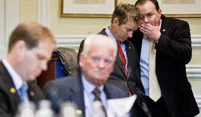 Sen. Mike Lee (right) of Utah confers with fellow Republican Sen. Rand Paul of Kentucky during a recent meeting of the Tea Party Debt Commission. The two lawmakers were elected in 2010 with help from the tea party. (T.J. Kirkpatrick/The Washington Times)