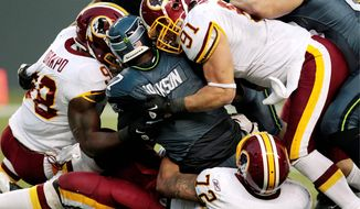 In addition to a critical third-down stop by the Washington Redskins' LaRon Landry, a sack of Seattle Seahawks quarterback Tarvaris Jackson on fourth down set up a lead-extending field goal late in Sunday's game. (AP Photo/Elaine Thompson)
