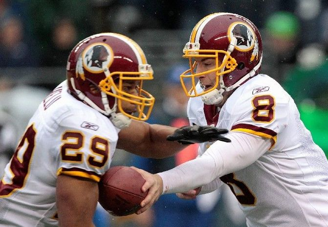 Redskins running back Roy Helu (29) took 23 handoffs from quarterback Rex Grossman on Sunday, rushing for 108 yards against a stingy Seattle defense. His previous career high for carries was 10. (Associated Press)