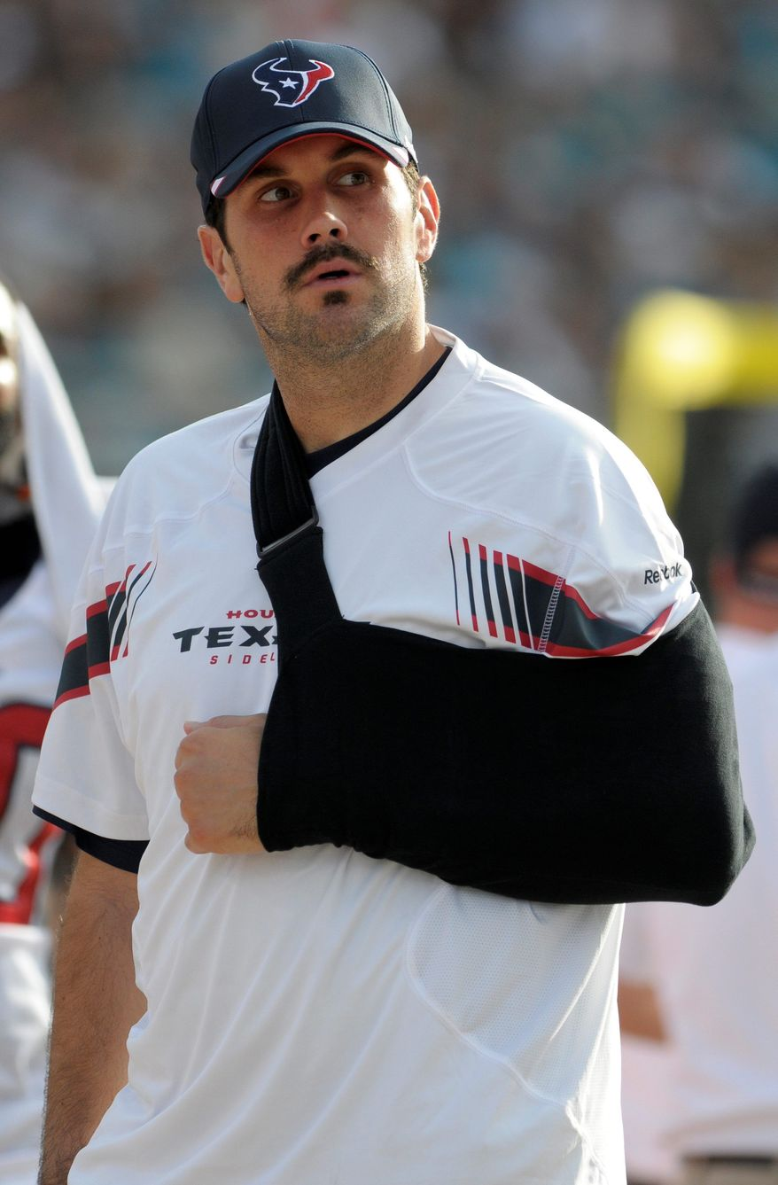 Houston Texans quarterback Matt Leinart stands on the sideline with his arm in a sling during the second half of an NFL football game against the Jacksonville Jaguars in Jacksonville, Fla., Sunday, Nov. 27, 2011. The Texans won 20-13. (AP Photo/Phelan M. Ebenhack)