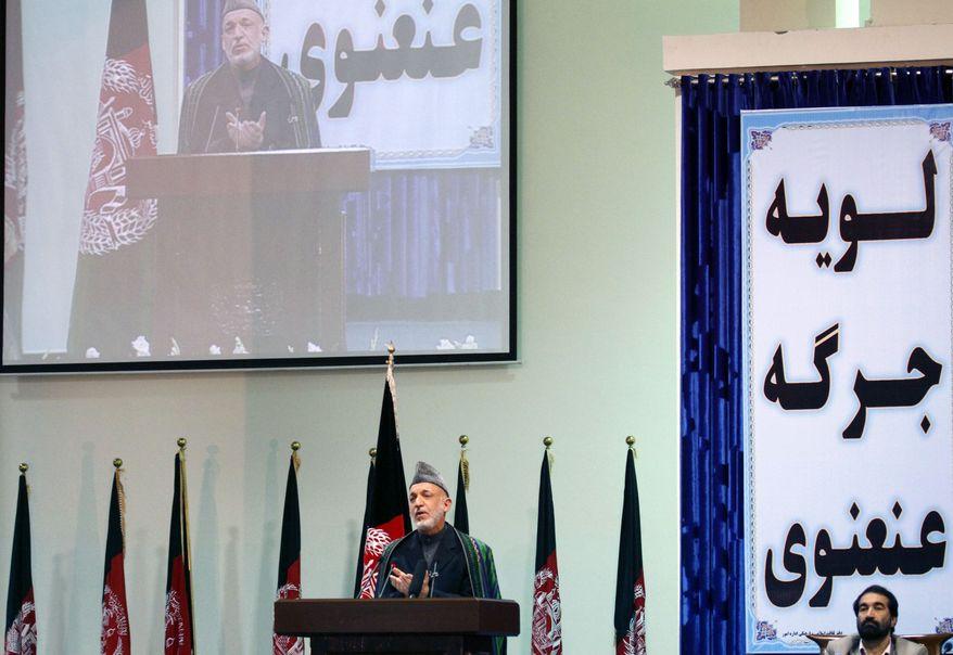 ** FILE ** Afghan President Hamid Karzai speaks during the last day of the Loya Jirga, or grand council, in Kabul, Afghanistan, on Saturday, Nov. 19, 2011. (AP Photo/Musadeq Sadeq)