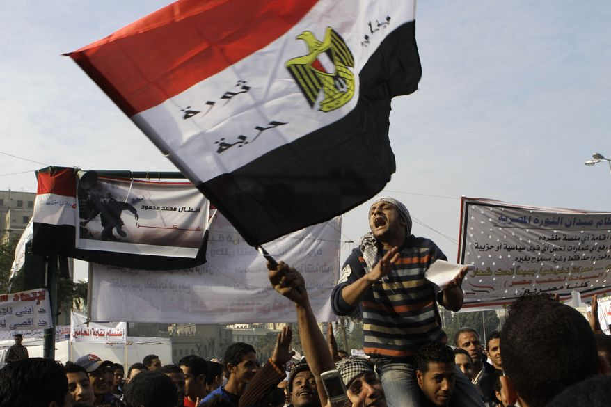 Protesters shout slogans against Egypt's military ruling council during a demonstration in Tahrir Square, the focal point of the Egyptian uprising, in Cairo on Sunday, Nov. 27, 2011. (AP Photo/Amr Nabil)
