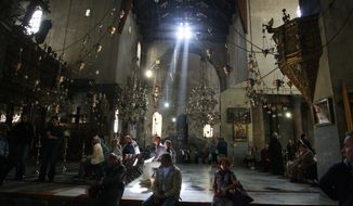 Pilgrims and tourists visit the Church of the Nativity, believed by many to be the birthplace of Jesus Christ, in the West Bank city of Bethlehem on Monday, Nov. 14, 2011. (AP Photo/Nasser Shiyoukhi)