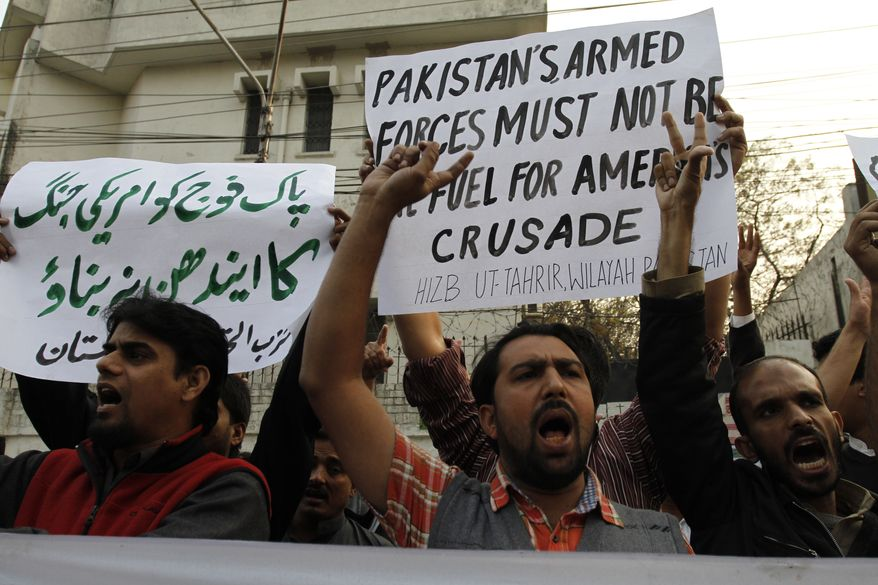 Protesters rally in Lahore, Pakistan, on Sunday, Nov. 27, 2011, to condemn a NATO airstrike on Pakistani troops that killed 24 along the nation's border with Afghanistan. (AP Photo/K.M. Chaudary)