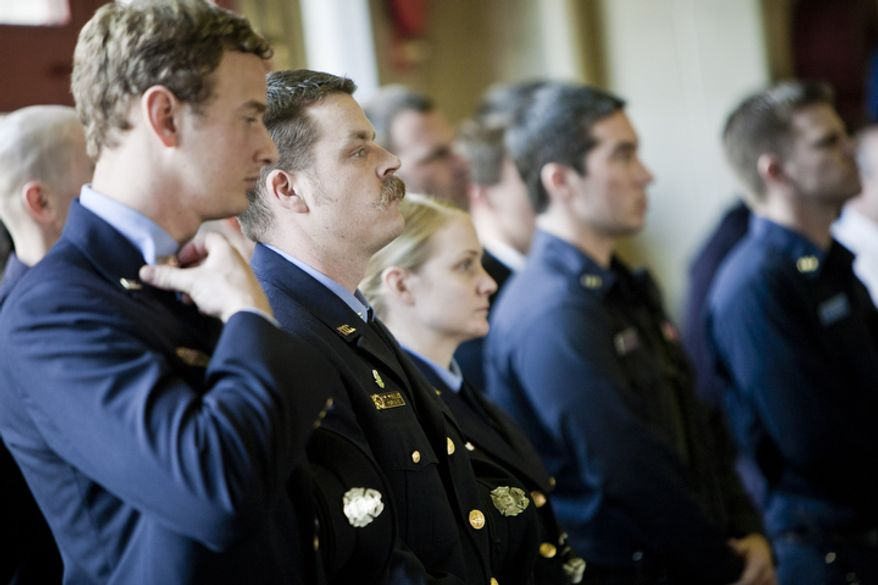 Firefighter Doug Wheeler, second from left, whose father is a 34-year veteran of the D.C. Fire Department and former captain of Engine Co. 24, stands with fellow Engine Co. 24 members during a centennial celebration.(T.J. Kirkpatrick/ The Washington Times)