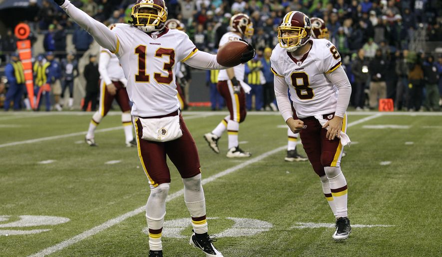 Washington Redskins' Anthony Armstrong celebrates his touchdown with quarterback Rex Grossman  in the fourth quarter against the Seattle Seahawks, Sunday, Nov. 27, 2011, in Seattle. (AP Photo/Ted S. Warren)