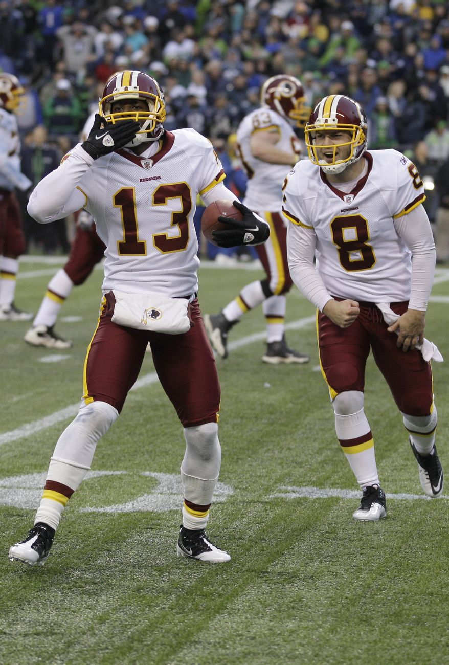 Washington Redskins Anthony Armstrong and Rex Grossman celebrate after a touchdown pass in the fourth quarter, Sunday, Nov. 27, 2011, in Seattle. (AP Photo/Ted S. Warren)