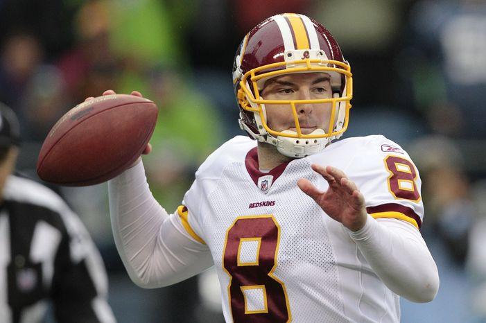 Washington Redskins quarterback Rex Grossman sets to throw in the first quarter of an NFL football game, Sunday, Nov. 27, 2011, in Seattle. (AP Photo/Elaine Thompson)