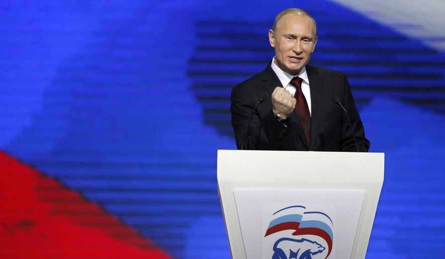 Russian Prime Minister Vladimir Putin speaks during a United Russia party congress in Moscow on Sunday, Nov. 27, 2011, at which he formally was nominated as the party's candidate for president in next March's election. (AP Photo/Alexander Zemlianichenko)