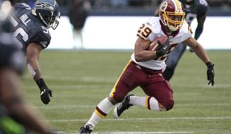 Washington Redskins Roy Helu runs downfield in the first half of an NFL football game against the Seattle Seahawks. (AP Photo/Elaine Thompson)