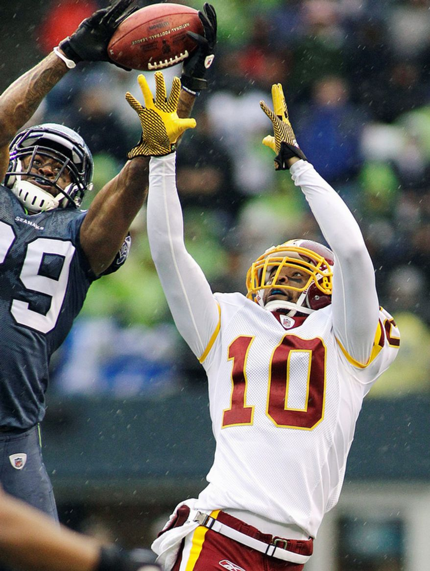 Seattle Seahawks' Brandon Browner, left, intercepts a pass intended for Washington Redskins Jabar Gaffney, right, in the first half in Seattle. (AP Photo/Ted S. Warren)