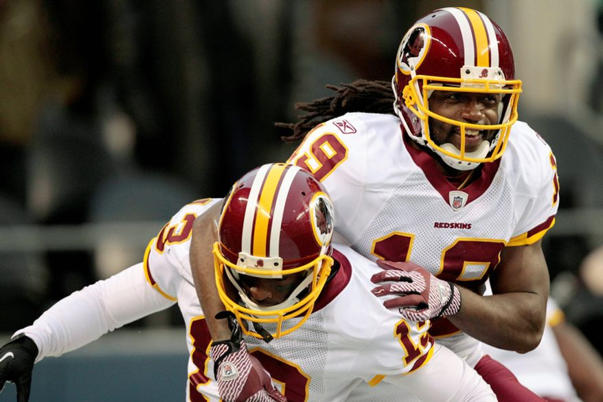 Washington Redskins' Anthony Armstrong, left, is congratulated by Donte' Stallworth, right, after Armstrong scored a touchdown in the second half. (AP Photo/Elaine Thompson)
