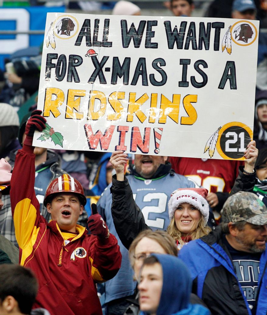 Washington Redskins hold a sign during the Redskins 23-17 win over the Seattle Seahawks. (AP Photo/Ted S. Warren)
