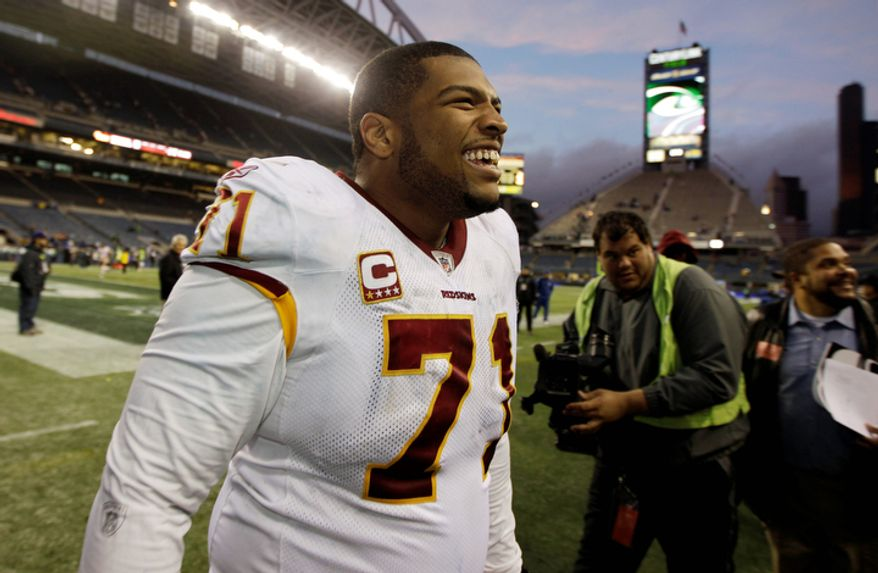 Washington Redskins' Trent Williams celebrates the Redskins' 23-17 win over the Seattle Seahawks in an NFL football game, Sunday, Nov. 27, 2011, in Seattle. (AP Photo/Ted S. Warren)