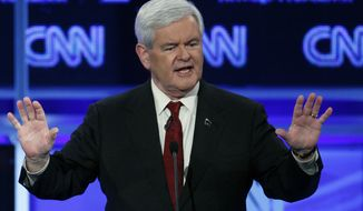 Former House Speaker Newt Gingrich, a candidate for the Republican presidential nomination, speaks during a GOP presidential debate in Washington on Tuesday, Nov. 22, 2011. (AP Photo/Evan Vucci)