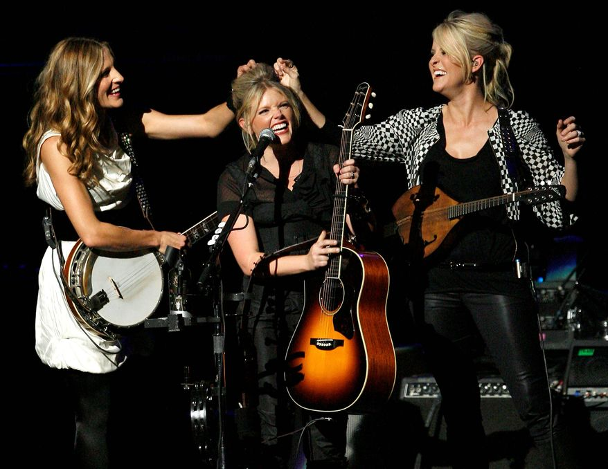 "The Dixie Chicks' VH1 ""Storytellers"" 2006 segment is newly available on DVD. Here the Chicks, Emily Robison, Natalie Maines and Martie Maguire, perform in 2007. (Associated Press)"