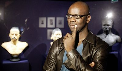 """""""You have to have the courage to say that each of us has prejudices, and these prejudices have a history,"""" says Lilian Thuram, the curator of an exhibit that examines the treatment of Africans, American Indians and Pacific Islanders as curiosities to be studied or for entertainment in circuses, expositions and shows. (Associated Press)"""