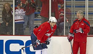 Dale Hunter (right), new head coach of the Washington Capitals, chats with Alex Ovechkin as Hunter takes to the ice with his team during their first practice together at the Kettler Capitals Iceplex in Arlington on Monday, Nov. 28, 2011. (Rod Lamkey Jr./The Washington Times)