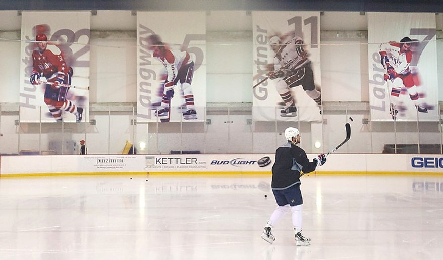 Washington Capitals' Mike Green practices alone on the ice prior to the team's first practice with new Head Coach and former Capitals player Dale Hunter, at the Kettler Capitals Iceplex in Arlington, Va, Monday, November 28, 2011. (photo by Rod Lamkey Jr/ The Washington Times)