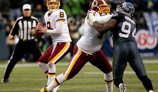 Rex Grossman is among the multiple players who received high marks for their performances Sunday in Seattle. (Associated Press)
